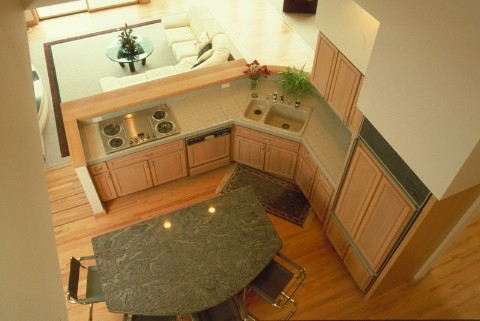 Granite Island, Formica Counter Tops and Armstrong Cabinetry